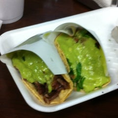 Photo taken at Tacos El Poblano by Laura H. on 3/25/2012