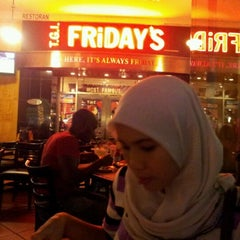 Photo taken at T.G.I. Friday's by Mohammad N. on 2/19/2012