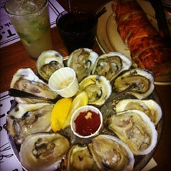 Photo taken at Stella's Fish Cafe & Prestige Oyster Bar by Jacob d. on 3/10/2012