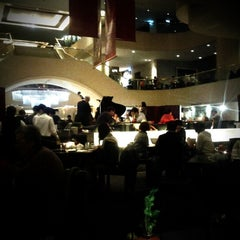 Photo taken at Azie Grand Café by Adams C. on 1/24/2012