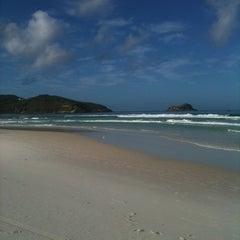Photo taken at Praia Grande by Ronaldo A. on 5/6/2012
