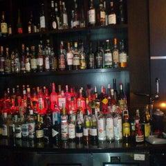 Photo taken at Uva Wine & Cocktail Bar by Nadja P. on 4/6/2012