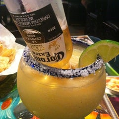 Photo taken at Los Chilaquiles - Bar & Mexican Grill by Chris M. on 3/2/2012