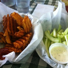 Photo taken at Gators Wing Shack by Susie P. on 2/12/2012