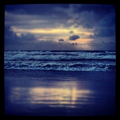 Photo taken at Cocoa Beach by Jonathan G. on 8/26/2012