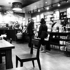 Photo taken at Starbucks by Alexander V. on 12/24/2011