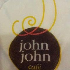 Photo taken at John John Cafe by Juliana P. on 3/15/2012