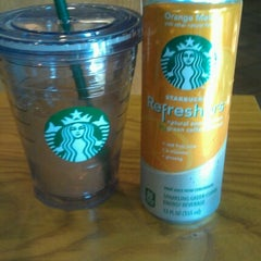 Photo taken at Starbucks by Emily W. on 8/7/2012