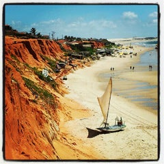 Photo taken at Praia de Canoa Quebrada by Anchieta J. on 6/23/2012