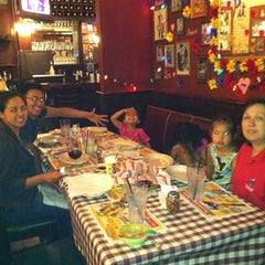 Photo taken at Buca di Beppo by Thuy T. on 6/8/2012