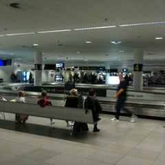 Photo taken at Bagageudlevering / Baggage Reclaim by Nine V. on 10/23/2011