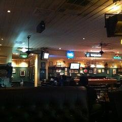 Photo taken at Mulligan's Irish Bar by pattamaporn m. on 4/9/2012