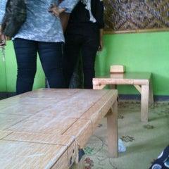 Photo taken at Waroeng Huhah by Nurul F. on 4/17/2012