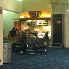 Photo taken at Gate 47 by Fabio Y. on 3/20/2012