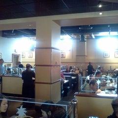 Photo taken at California Pizza Kitchen by Usman M. on 2/18/2012