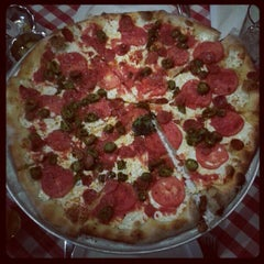 Photo taken at Grimaldi's Coal Brick-Oven Pizzeria by Cristopher on 7/31/2012