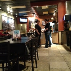 Photo taken at Brozinni Pizzeria by Rob W. on 12/16/2011