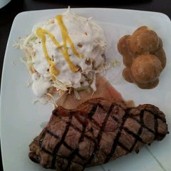 Photo taken at Me'nate Steak House by Win on 2/4/2012