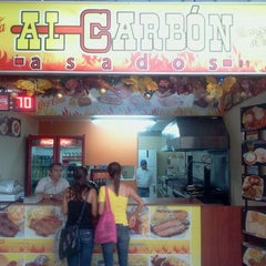 Photo taken at Al Carbon Asado C.C. Unicentro by Andres G. on 12/27/2011