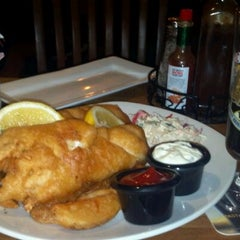 Photo taken at Tigín Irish Pub and Restaurant by Diana H. on 3/31/2012