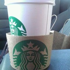 Photo taken at Starbucks by Justine O. on 3/15/2012