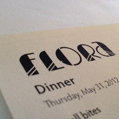 Photo taken at Flora Restaurant & Bar by Steven T. on 6/1/2012
