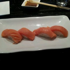 Photo taken at Sushi Axiom by Everett N. on 2/23/2012