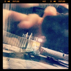 Photo taken at Gate 11 by Jeff A. on 3/31/2012