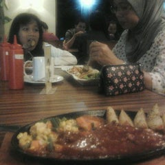 Photo taken at AROSA cafe & family karaoke by Firman P. on 3/14/2012