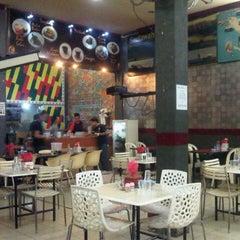 Photo taken at Grand Keude Kupie Ulee Kareng & Gayo by Dedy I. on 7/29/2012