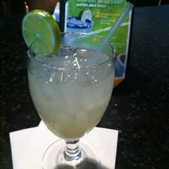 Photo taken at Iron Cactus Mexican Grill & Margarita Bar by Aly C. on 6/26/2012