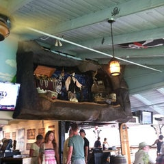 Photo taken at Captain Jack's Island Grill by Julie G. on 3/4/2012