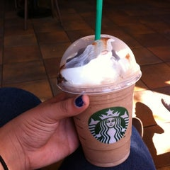Photo taken at Starbucks by Xenia T. on 4/6/2012