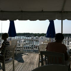 Photo taken at Tugboats Restaurant by Teresa H. on 8/4/2012