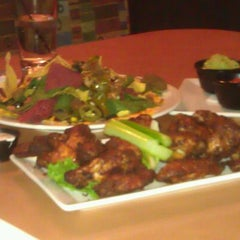 Photo taken at Boston Pizza by Oscar P. on 2/15/2012