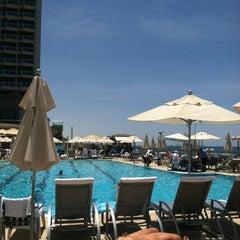 Photo taken at Hilton Pool by Elizabeth O. on 5/23/2012