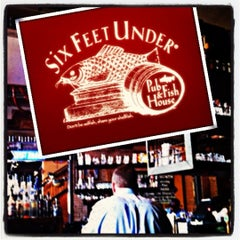 Photo taken at Six Feet Under Pub & Fish House by Andy P. on 3/21/2012