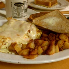 Photo taken at McKenna's Cafe by Kapado F. on 3/25/2012