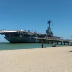 Photo taken at Beach by the USS Lexington by Amy R. on 7/8/2012