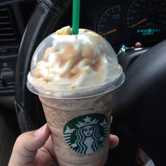 Photo taken at Starbucks by Chelly B. on 7/9/2012