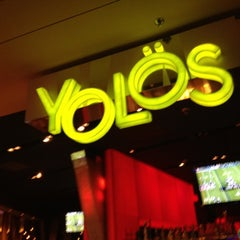Photo taken at Yolös Mexican Grill by Dan K. on 8/25/2012
