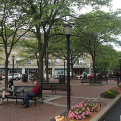 Photo taken at Davis Square by Kenya W. on 6/11/2012