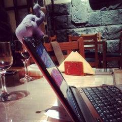Photo taken at Artbridge Bookstore Café by Lia M. on 4/19/2012