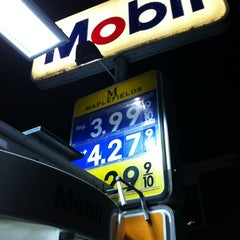 Photo taken at Mobil by Josh F. on 4/29/2012