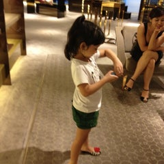 Photo taken at Gucci Hanoi by Hoa on 8/20/2012