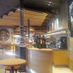 Photo taken at Starbucks Coffee by Lorenzo M. on 7/24/2012
