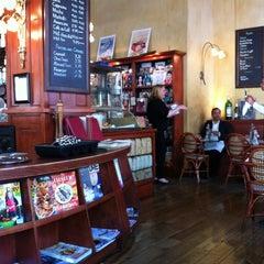 Photo taken at Café de la Presse by Lora T. on 6/5/2012