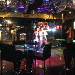 Photo taken at Pitstop Bar & Lounge by Maya A. on 2/18/2012