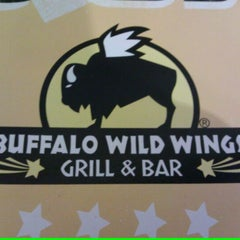 Photo taken at Buffalo Wild Wings by Brandon R. on 4/3/2012