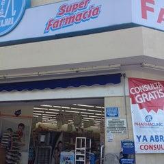 Photo taken at Farmacias Guadalajara by Julio D. on 7/21/2012